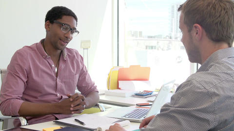 Businessman Interviewing Candidate For Job In Design Agency Live Action