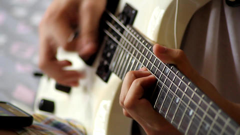 Hands playing an electric guitar Footage