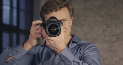 Slow Motion Portrait of Successful Photographer Takes Pictures with the Camera.  Footage