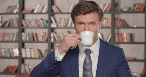 Slow Motion Portrait of Successful Businessman Drinking…, Live Action