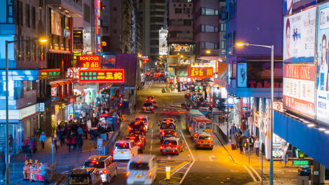 Crowded area with pedestrians and heavy traffic in modern asia city Hong Kong do Footage