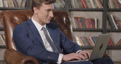 Slow Motion Portrait of Successful Confident Businessman Working with Laptop Sit Footage