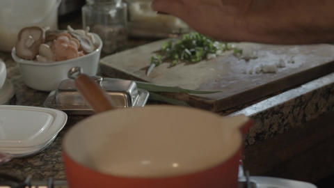 Cook trowing oil in a pan Footage