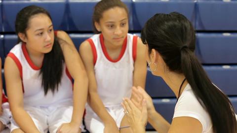 Coach Of Female High School Basketball Team Gives Team Talk Live Action