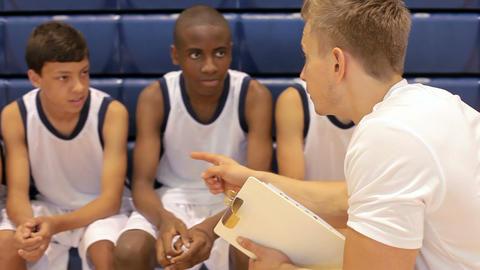 Male High School Basketball Team Having Team Talk With Coach Live Action