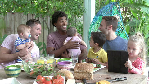 Group Of Fathers With Children Enjoying Outdoor Meal At Home Footage