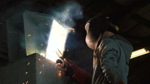 Welder welds the parts of the structure Filmmaterial