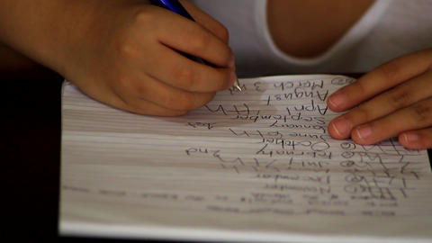 Hands of a child writing on paper Footage