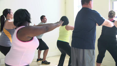 Fitness Instructor In Exercise Class For Overweight People Footage