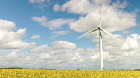 Time Lapse Sequence Of Wind Turbine In Field Of Rape Footage