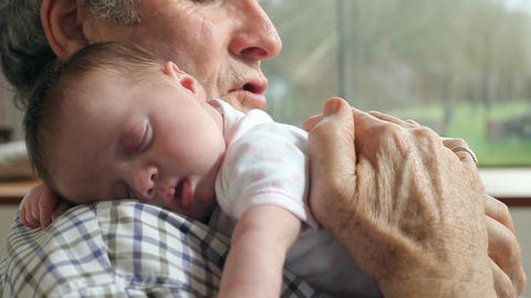 Grandfather Holding Sleeping Newborn Baby Granddaughter Footage