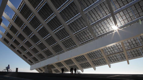 People under a large solar panel. Barcelona City Footage