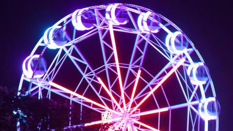 Glowing night Ferris wheel Footage