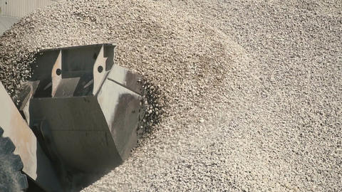 Tractor bucket moving crushed stone Footage