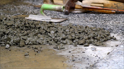 Cement, gravel and sand being mixed Live Action