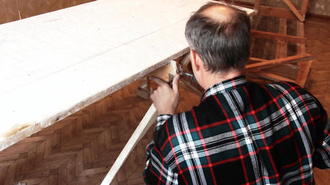 Man Screwing a screw into the wood Footage