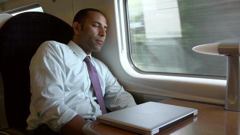 Businessman Resting On Train Journey Footage