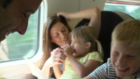 Family Relaxing On Train Journey Footage