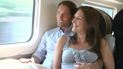 Couple Relaxing On Train Journey Together Footage