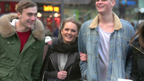 Slow Motion Sequence Of Friends Shopping Outdoors Together Footage
