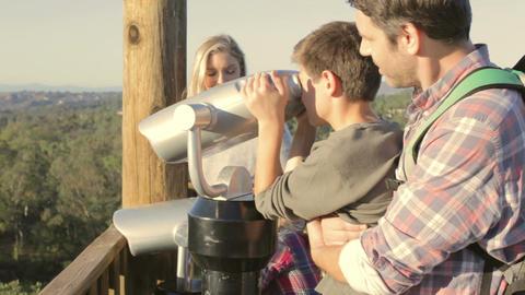 Family Looking Through Binoculars On Viewing Platform Footage
