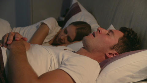 Woman Disturbed By Man's Snoring As They Lie In Bed Footage