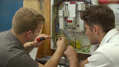 Teacher Helping Student Training To Be Electrician Live Action
