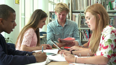 Group Of Students Working Together In Library Together Footage