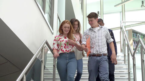 College Students Walking Down Stairs In Slow Motion Live Action