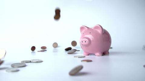 Coins Falling Around Piggy Bank In Slow Motion Footage