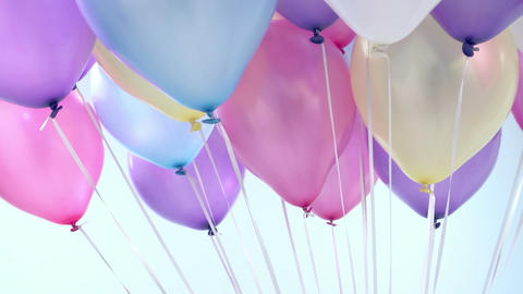 Studio Sequence Of Multi-Colored Balloons Rotating Footage