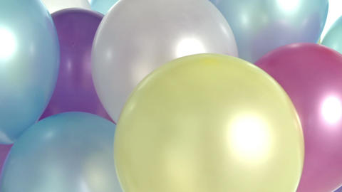 Studio Shot Of Colorful Balloons Rotating In Slow Motion Live Action