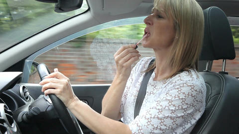 Woman Putting On Make Up Whilst Driving Car Live Action