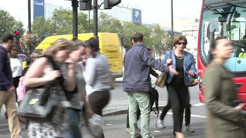 Time Lapse Sequence Of Busy Pedestrian Crossing With Traffic Footage
