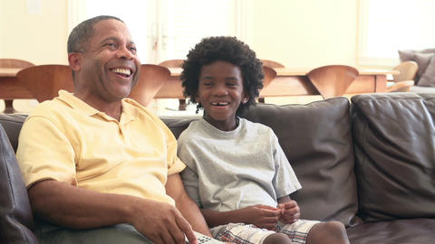 Grandfather And Grandson Watching Television Together Footage