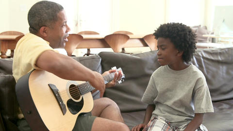 Grandfather Teaching Grandson To Play Guitar Footage