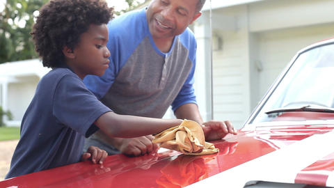 Grandfather And Grandson Cleaning Restored Classic Car Footage