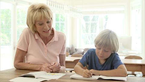 Grandmother Helping Grandson With Homework Footage