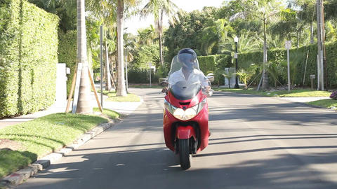 Slow Motion Sequence Of Man Riding Motor Scooter On Road Footage