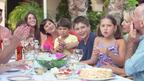 Family Group Celebrating Birthday On Terrace In Slow Motion Footage