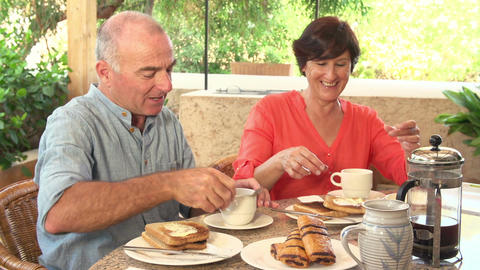 Senior Hispanic Couple Eating Breakfast At Home Together Footage