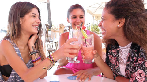 Group Of Female Friends Drinking Cocktails At Outdoor Bar Footage
