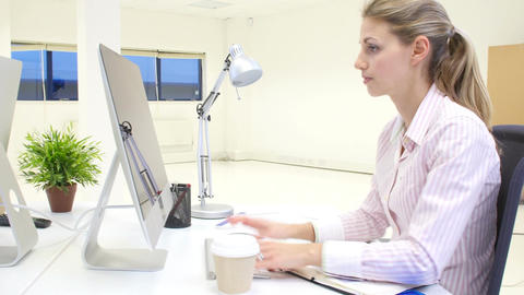 Businesspeople Working At Desks In Modern Office Live Action