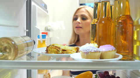Woman Taking Bottle Of White Wine From The Fridge Footage