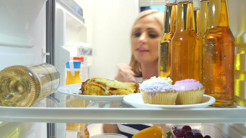 Woman Taking Plate Of Leftover Lasagne From The Fridge Footage
