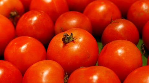 Red tomatoes in stall at supermarket Footage