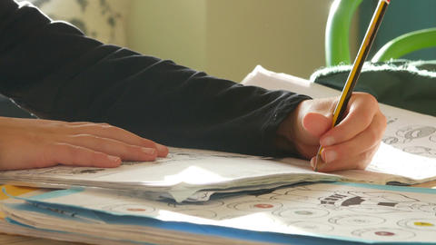 Close Up Of Girl Sitting At Table Indoors Doing Homework Footage