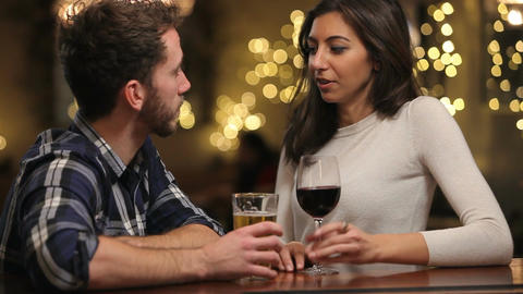 Couple On Date Enjoying Evening Drinks In Bar Footage