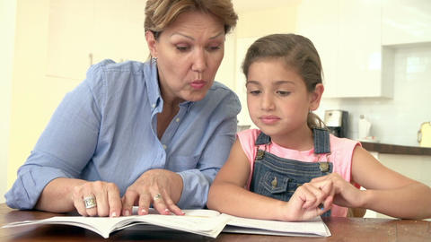Grandmother Helping Granddaughter With Homework Footage