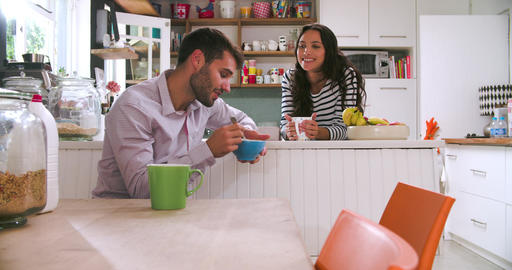 Young Couple Eating Breakfast In Kitchen Together Live Action